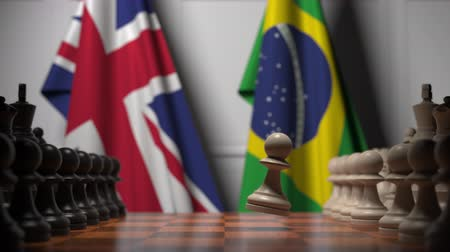 bandiera brasiliana : Chess game against flags of Great Britain and Brazil. Political competition related 3D animation
