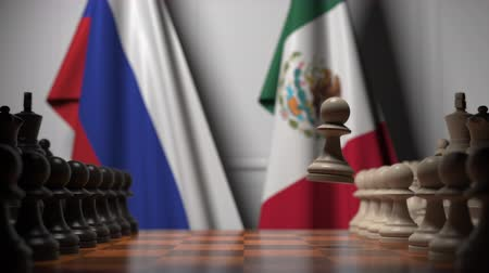 ライバル : Chess game against flags of Russia and Mexico. Political competition related 3D animation 動画素材
