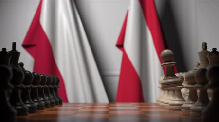 конкурировать : Flags of Poland and Austria behind pawns on the chessboard. Chess game or political rivalry related 3D animation