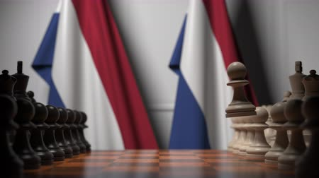соперничество : Chess game against flags of Netherlands. Political competition related 3D animation Стоковые видеозаписи