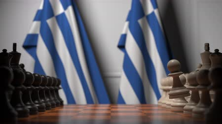 autoridade : Flags of Greece behind pawns on the chessboard. Chess game or political rivalry related 3D animation