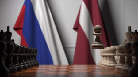 Латвия : Flags of Russia and Latvia behind pawns on the chessboard. Chess game or political rivalry related 3D animation