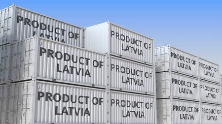 Латвия : Cargo containers with PRODUCT OF LATVIA text. Latvian import or export related loopable 3D animation Стоковые видеозаписи