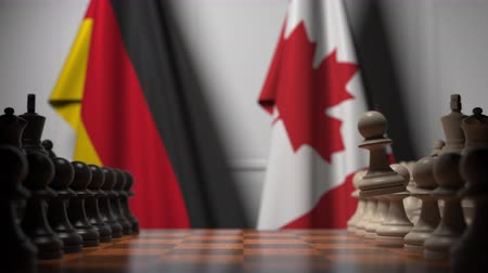 drapeau canadien : Chess game against flags of Germany and Canada. Political competition related 3D animation Vidéos Libres De Droits