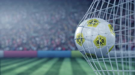 symbolic : Borussia Dortmund football club logo on the ball in football net. Editorial conceptual 3D animation