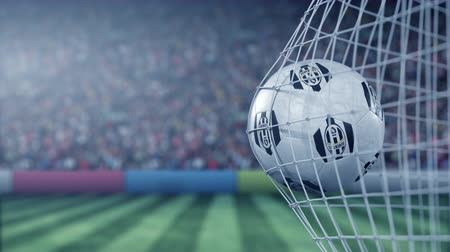 スコア : Juventus football club logo on the ball in football net. Editorial conceptual 3D animation