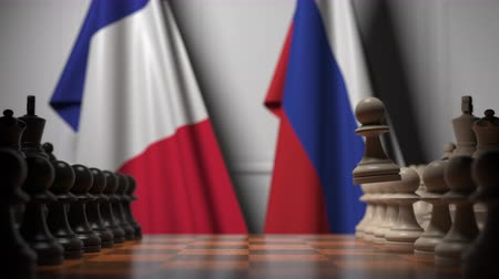 treaty : Chess game against flags of France and Russia Stock Footage
