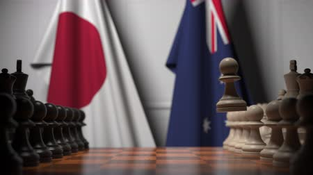 конкурировать : Chess game against flags of Japan and Australia. Political competition related 3D animation Стоковые видеозаписи