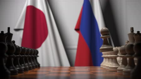 tablero de ajedrez : Chess game against flags of Japan and Russia. Political competition related 3D animation