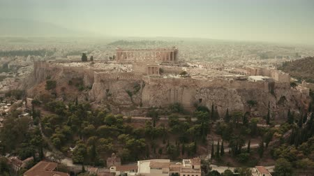 aerial athens : Aerial hyperlapse of the famous ancient Greek temple Parthenon on Acropolis of Athens, the main landmark of Greece