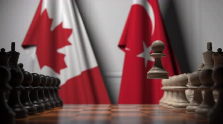 canadense : Chess game against flags of Canada and Turkey. Political competition related 3D animation