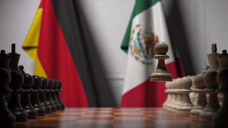 treaty : Chess game against flags of Germany and Mexico. Political competition related 3D animation Stock Footage