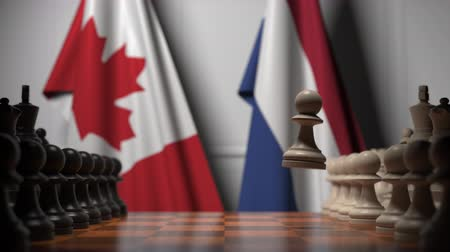 drapeau canadien : Chess game against flags of Canada and Netherlands. Political competition related 3D animation