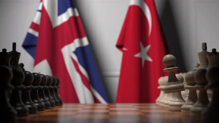 turkse vlag : Chess game against flags of Great Britain and Turkey. Political competition related 3D animation