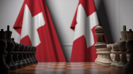 muhalefet : Chess game against flags of Switzerland. Political competition related 3D animation Stok Video