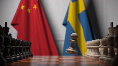 соперничество : Chess game against flags of China and Sweden. Political competition related 3D animation Стоковые видеозаписи