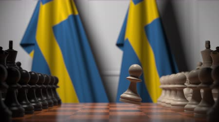 meetings : Flags of Sweden behind pawns on the chessboard. Chess game or political rivalry related 3D animation Stock Footage
