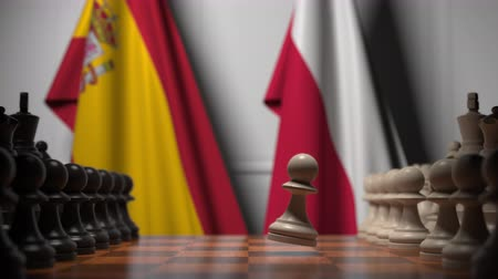 spaniard : Flags of Spain and Poland behind pawns on the chessboard. Chess game or political rivalry related 3D animation