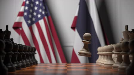 соперничество : Flags of USA and Thailand behind pawns on the chessboard. Chess game or political rivalry related 3D animation Стоковые видеозаписи