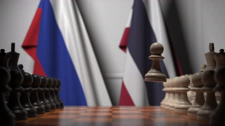 xadrez : Flags of Russia and Thailand behind pawns on the chessboard. Chess game or political rivalry related 3D animation