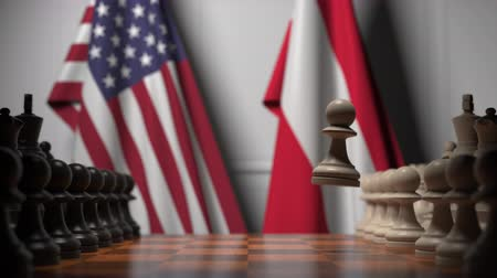 конкурировать : Flags of USA and Austria behind pawns on the chessboard. Chess game or political rivalry related 3D animation Стоковые видеозаписи
