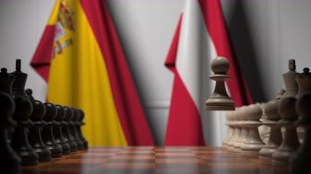 šachy : Flags of Spain and Austria behind pawns on the chessboard. Chess game or political rivalry related 3D animation