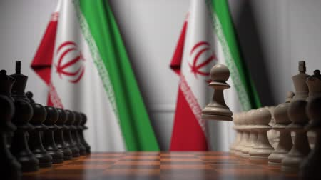 イラン : Flags of Iran behind pawns on the chessboard. Chess game or political rivalry related 3D animation
