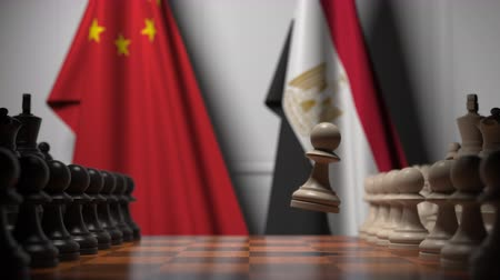 конкурировать : Flags of China and Egypt behind pawns on the chessboard. Chess game or political rivalry related 3D animation Стоковые видеозаписи