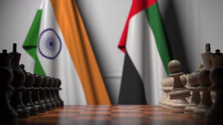 соперничество : Flags of India and UAE behind pawns on the chessboard. Chess game or political rivalry related 3D animation Стоковые видеозаписи