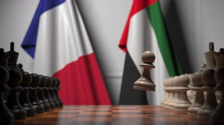конкурировать : Flags of France and UAE behind pawns on the chessboard. Chess game or political rivalry related 3D animation Стоковые видеозаписи