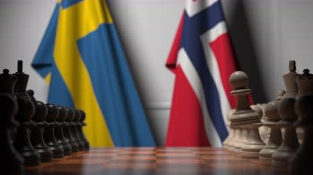 İsveççe : Flags of Sweden and Norway behind pawns on the chessboard. Chess game or political rivalry related 3D animation Stok Video
