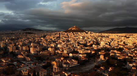 aerial athens : Aerial shot of the cityscape of Athens and the Lycabettus Hill at sunset, Greece