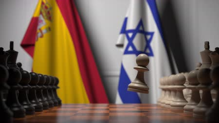 spaniard : Flags of Spain and Israel behind pawns on the chessboard. Chess game or political rivalry related 3D animation
