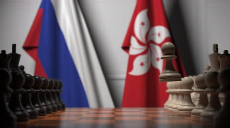 конкурировать : Flags of Russia and Hong Kong behind pawns on the chessboard. Chess game or political rivalry related 3D animation