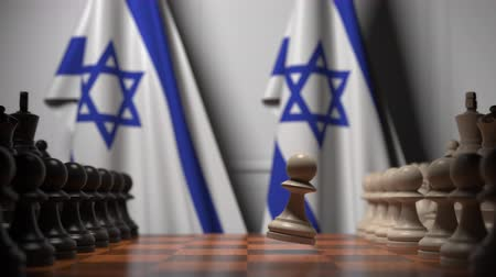 конкурировать : Flags of Israel and Israel behind pawns on the chessboard. Chess game or political rivalry related 3D animation Стоковые видеозаписи