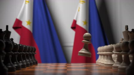 šachy : Flags of Philippines behind pawns on the chessboard. Chess game or political rivalry related 3D animation Dostupné videozáznamy