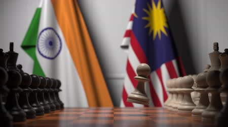 ライバル : Flags of India and Malaysia behind pawns on the chessboard. Chess game or political rivalry related 3D animation