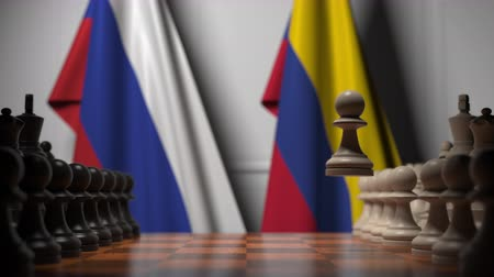 colômbia : Flags of Russia and Colombia behind pawns on the chessboard. Chess game or political rivalry related 3D animation