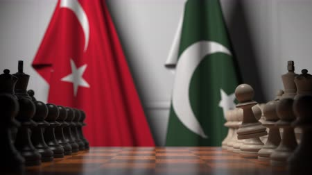 Пакистан : Flags of Turkey and Pakistan behind pawns on the chessboard. Chess game or political rivalry related 3D animation