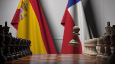 spaniard : Flags of Spain and Chile behind pawns on the chessboard. Chess game or political rivalry related 3D animation