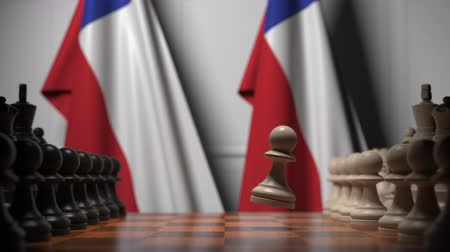 chileno : Flags of Chile behind pawns on the chessboard. Chess game or political rivalry related 3D animation Archivo de Video