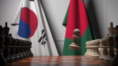 概念 : Flags of South Korea and Bangladesh behind pawns on the chessboard. Chess game or political rivalry related 3D animation 影像素材
