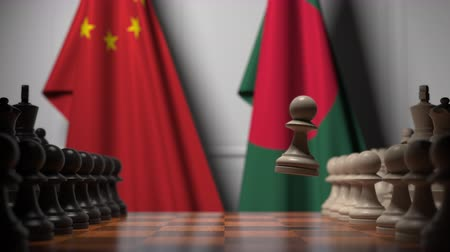 ライバル : Flags of China and Bangladesh behind pawns on the chessboard. Chess game or political rivalry related 3D animation