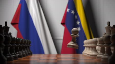 šachy : Flags of Russia and Venezuela behind pawns on the chessboard. Chess game or political rivalry related 3D animation