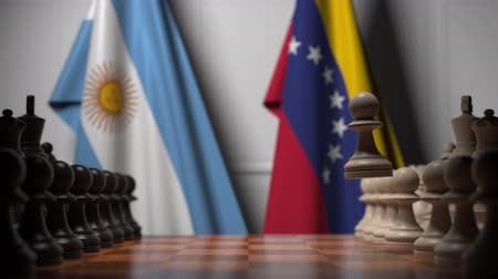 tablero de ajedrez : Flags of Argentina and Venezuela behind pawns on the chessboard. Chess game or political rivalry related 3D animation