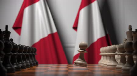perui : Flags of Peru behind pawns on the chessboard. Chess game or political rivalry related 3D animation Stock mozgókép