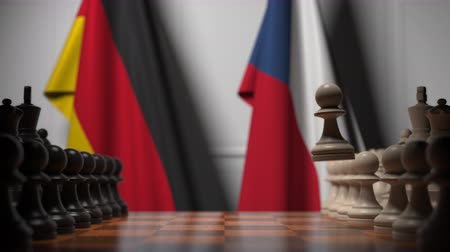 соперничество : Flags of Germany and the Czech Republic behind pawns on the chessboard. Chess game or political rivalry related 3D animation