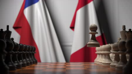 tablero de ajedrez : Flags of Chile and Peru behind pawns on the chessboard. Chess game or political rivalry related 3D animation