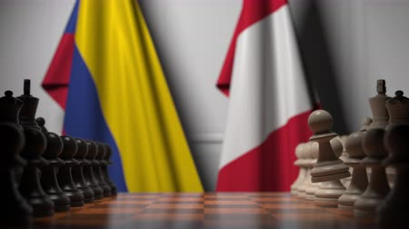 autoridade : Flags of Colombia and Peru behind pawns on the chessboard. Chess game or political rivalry related 3D animation