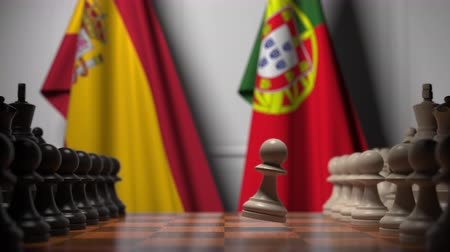 spaniard : Flags of Spain and Portugal behind pawns on the chessboard. Chess game or political rivalry related 3D animation Stock Footage